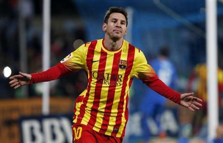 Barcelona's Lionel Messi celebrates after scoring his second goal against Getafe during their Spanish King's Cup soccer match in Getafe
