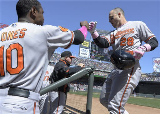 Baltimore Orioles' Steve Pearce rounds the bases on a solo home run off Minnesota Twins starting pitcher Scott Diamond in the sixth inning of a baseball game, Sunday, May 12, 2013 in Minneapolis. (AP Photo/Jim Mone)