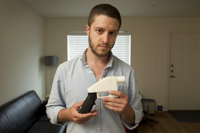 Cody Wilson, the founder of Defense Distributed, shows a plastic handgun made on a 3D-printer at his home in Austin, Texas. Eight states filed suit Monday, July 30, 2018, against the Trump administration over its decision to allow a Texas company to publish downloadable blueprints for a 3D-printed gun. (Jay Janner/Austin American-Statesman via AP, File)