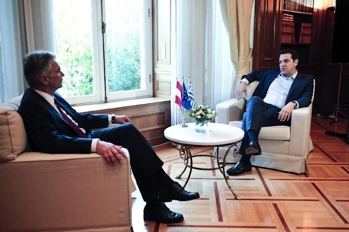 Greek Prime Minister Alexis Tsipras (R) speaks with Austrian Chancellor Werner Faymann during their meeting in Athens on June 17, 2015 (AFP Photo/Angelos Tzortzinis)