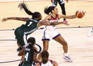 Nigeria forward/center Elizabeth Williams (1) battles for the ball against United States forward A'Ja Wilson during the first half of a pre-Olympic exhibition basketball game in Las Vegas on Sunday, July 18, 2021. (Chase Stevens/Las Vegas Review-Journal via AP)