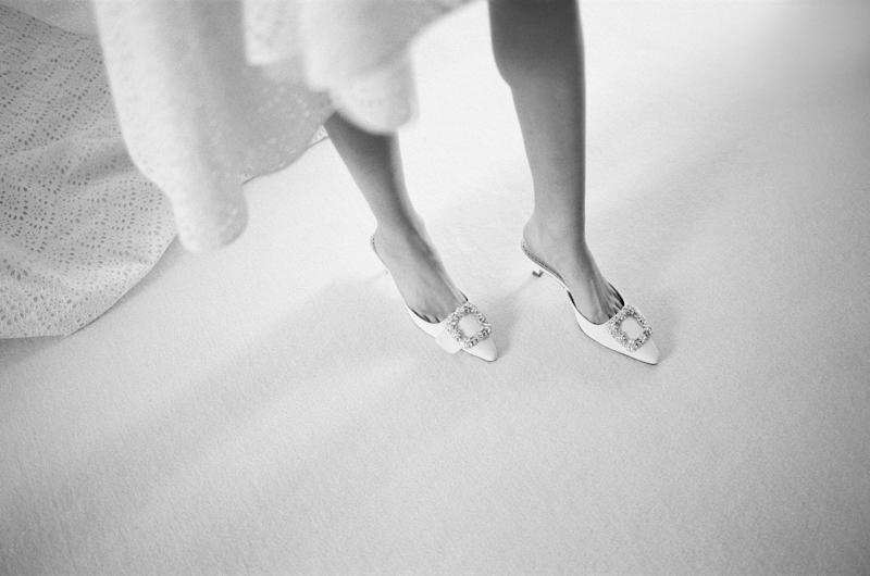 Happy feet! I found the perfect two-inch white satin slides from Manolo Blahnik.