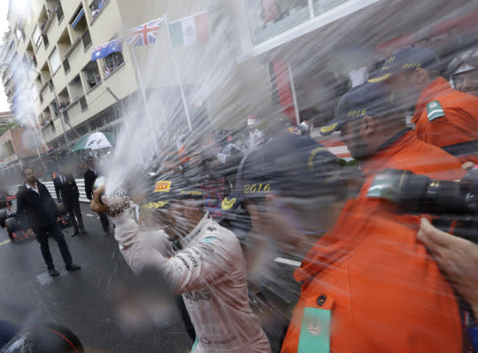 <p>Mercedes driver Lewis Hamilton of Britain sprays champagne as he celebrates his win at the Monaco Formula One Grand Prix in Monaco, Sunday, May 29, 2016. <em>(AP Photo/Claude Paris)</em> </p>