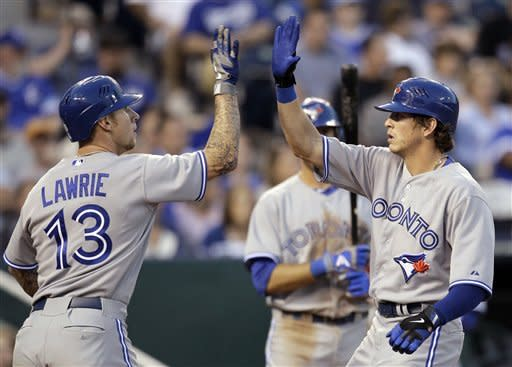Toronto Blue Jays' Colby Rasmus, right, celebrates with teammate Brett Lawrie (13) after hitting a two-run home run during the sixth inning of a baseball game against the Kansas City Royals, Saturday, April 21, 2012, in Kansas City, Mo. (AP Photo/Charlie Riedel)