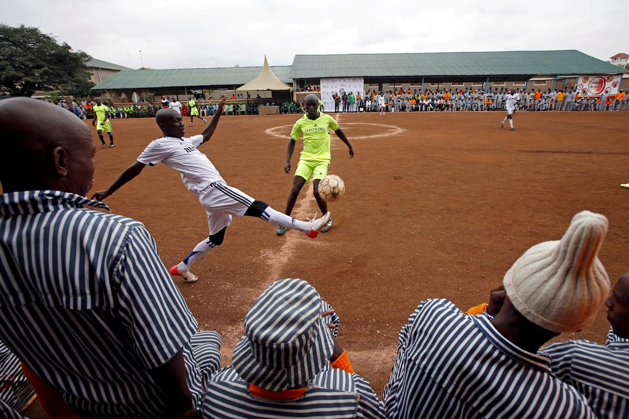 <p>Kenyan prisoners watch a mock World Cup soccer match between Russia and Saudi Arabia, as part of a monthlong soccer tournament involving eight prison teams at the Kamiti Maximum Security Prison, Kenya's largest prison facility, near Nairobi, on June 14, 2018. (Photo: Baz Ratner/Reuters) </p>