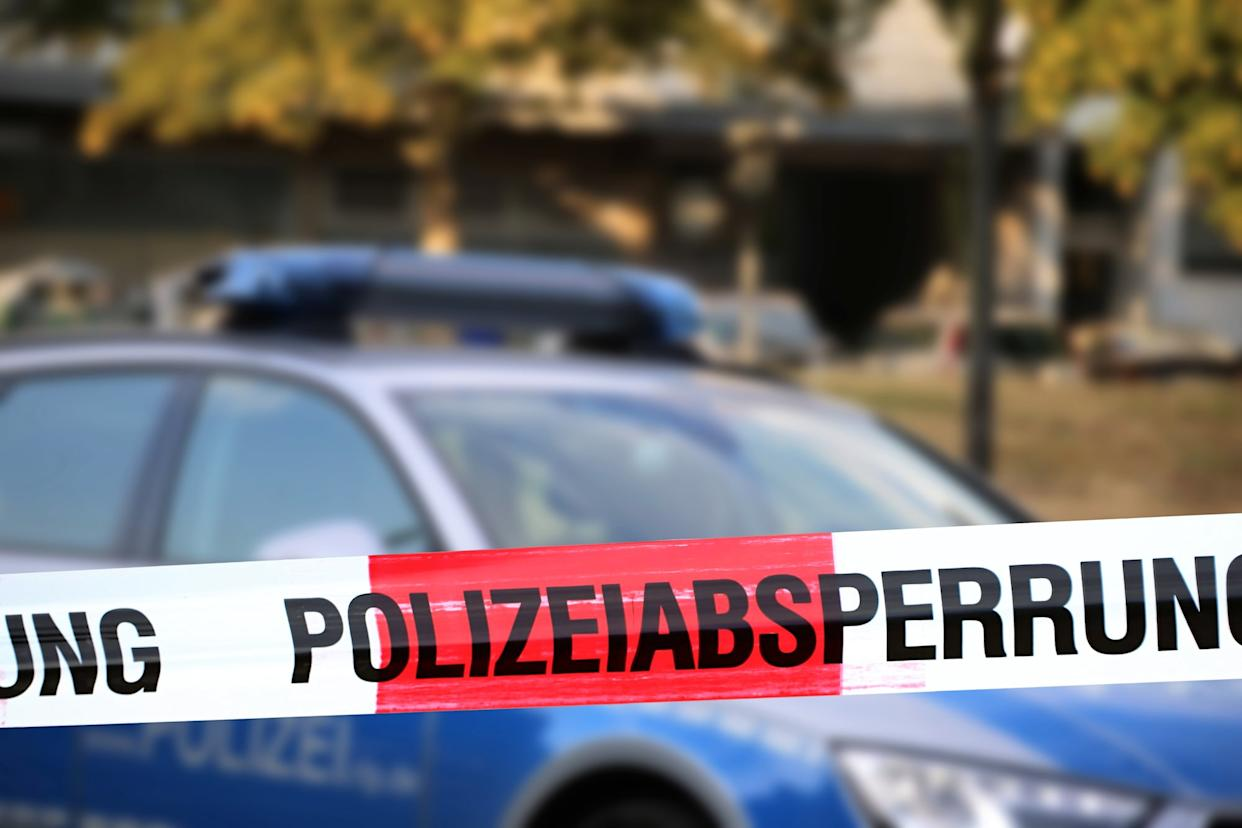"Cordon tape with the word ""Polizeiabsperrung"