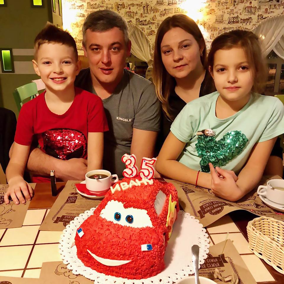 Pic Shows: Ivan Smirnov with family;  This father of two is trapped in his own body being fully conscious but barely able to move or talk after doctors repeatedly misdiagnosed his stroke.