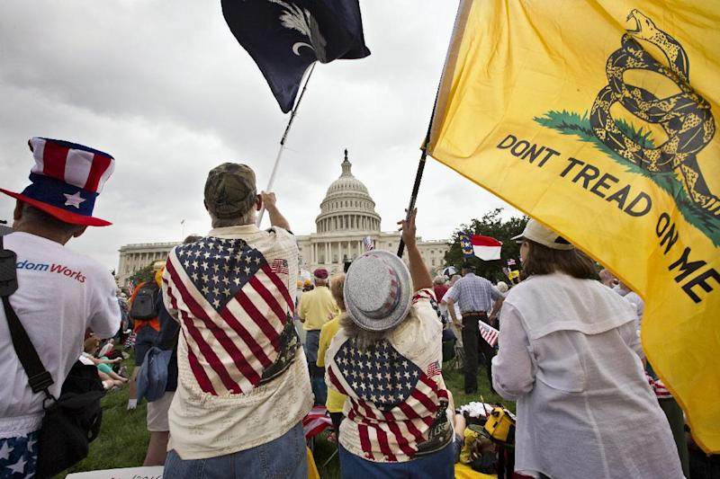 FILE - In this June 19, 2013, file photo, Tea Party activists rallying in front of the U.S. Capitol in Washington. The movement's top strategists concede the tea party is quieter today, by design. It has matured, they said, from a protest movement to a political movement. Large-scale rallies have given way to strategic letter-writing and phone-banking campaigns to push or oppose legislative agendas in Washington and state capitals. (AP Photo/J. Scott Applewhite, File)