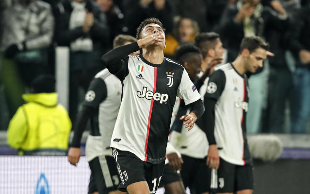 Juventus' Paulo Dybala celebrates after scoring the opening goal during the Champions League group D soccer match between Juventus and Atletico Madrid at the Allianz stadium in Turin, Italy, Tuesday, Nov. 26, 2019. (AP Photo/Antonio Calanni)