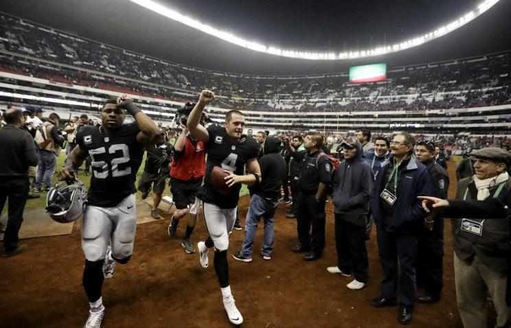 Khalil Mack and Derek Carr helped lead the Raiders back to the playoffs in 2016. (AP)