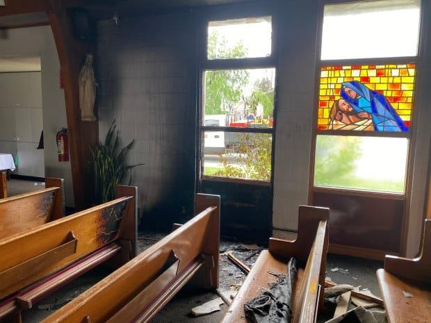 An early morning fire July 1 at the St. Patrick Co-Cathedral in Yellowknife left several pews charred. RCMP have called the fire suspicious.  (John Van Dusen/CBC - image credit)