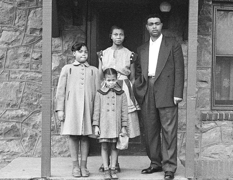 Linda Brown (left) with her parents, Leola and Oliver, and little sister Terry Lynn in front of their house in Topeka, Kansas, in 1954.
