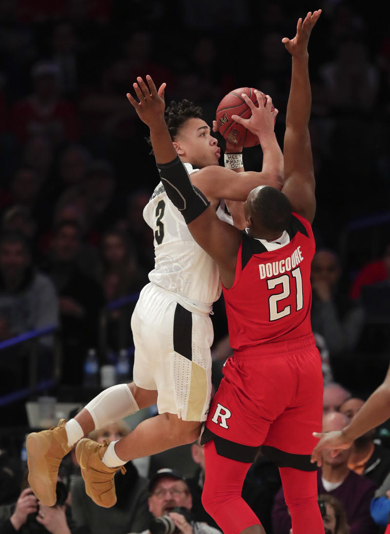 Purdue fights off feisty Rutgers 82-75 to advance in Big Ten