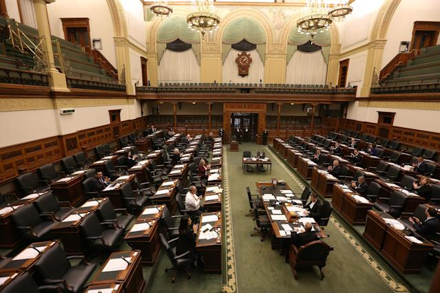 MPPs applaud as emergency legislation aimed at protecting workers who are forced to stay home due to the COVID-19 pandemic is passed in the Ontario Legislature. The Province of Ontario held a 1 pm emergency sitting of the legislator to pass COVID-19 legislation. Just 24 MPPs from all parties will be on hand so they can maintain social distancing in the house. in Toronto. March 19, 2020. (Steve Russell/Toronto Star via Getty Images)