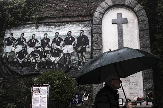 A man walks near a monument dedicated to the Grande Torino team wiped out in an air crash (AFP Photo/MARCO BERTORELLO)