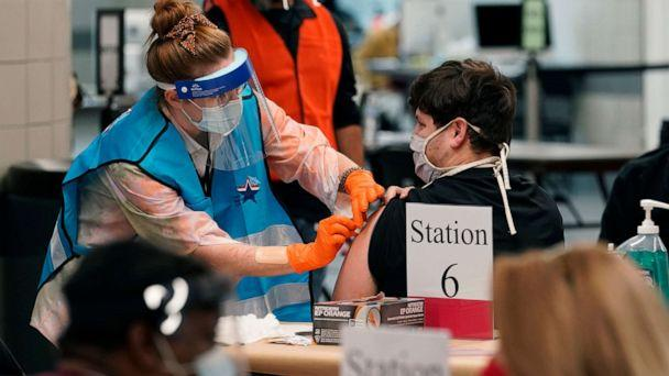 PHOTO: A health care worker administers a COVID-19 vaccination at the new Alamodome COVID-19 vaccine site, Jan. 11, 2021, in San Antonio, Texas. (Eric Gay/AP)