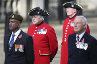 Veterans stand, ahead of the start of the Remembrance Sunday service at the Cenotaph, in Whitehall, London, Sunday Nov. 8, 2020. (Chris Jackson/Pool Photo via AP)