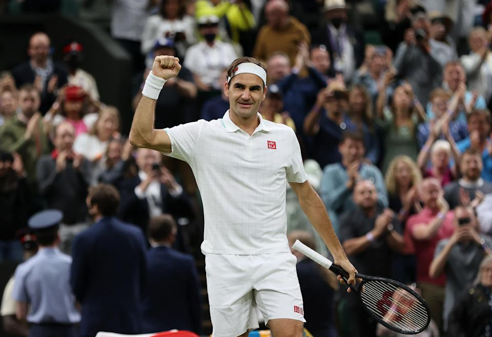 LONDON, ENGLAND - JULY 05: Roger Federer of Switzerland celebrates victory after winning his Men's Singles Fourth Round match against Lorenzo Sonego of Italy during Day Seven of The Championships - Wimbledon 2021 at All England Lawn Tennis and Croquet Club on July 05, 2021 in London, England. (Photo by Clive Brunskill/Getty Images)