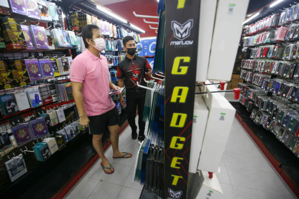 Shamir Sopian, 32, who owns the Manjoy Gadget in Pengkalan, Ipoh reopened his mobile phone accessories shop as the government allowed certain sectors to operate as the state enters Phase Two of the National Recovery Plan. — Picture by Farhan Najib