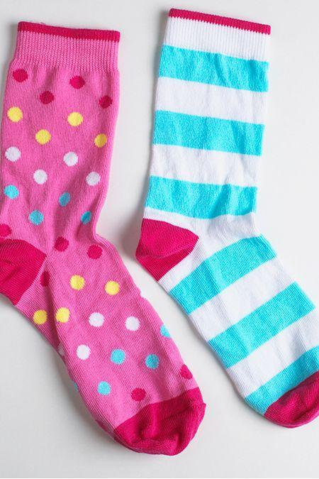 """<p>So you'll always have a <a href=""""https://www.dollartree.com/search/go?w=socks"""" rel=""""nofollow noopener"""" target=""""_blank"""" data-ylk=""""slk:matching pair"""" class=""""link rapid-noclick-resp"""">matching pair</a>, no matter how close to <a href=""""https://www.goodhousekeeping.com/health/news/a46417/shoes-without-socks-danger/"""" rel=""""nofollow noopener"""" target=""""_blank"""" data-ylk=""""slk:laundry day"""" class=""""link rapid-noclick-resp"""">laundry day</a> it gets.</p>"""
