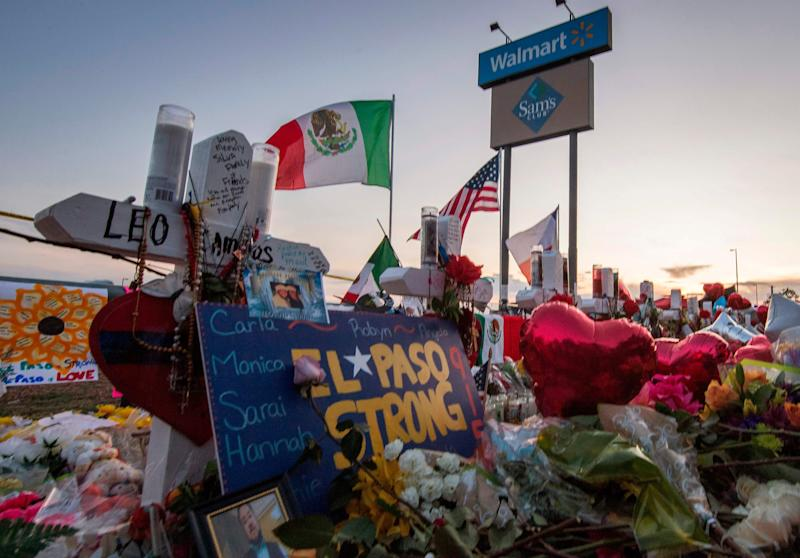 People pray and pay their respects at a makeshift memorial for victims of a shooting in El Paso, Texas.