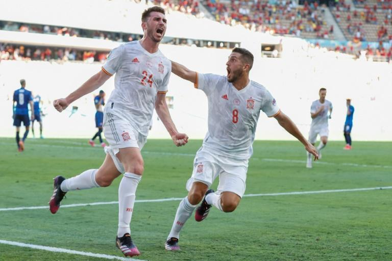 Aymeric Laporte (L) scored his first goal for Spain in the rout of Slovakia after switching his international allegiance from France