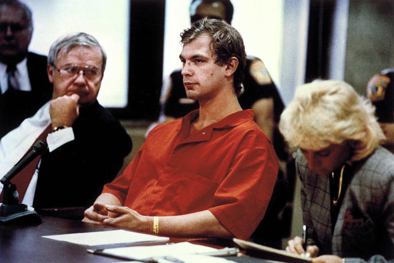 Accused serial killer Jeffrey L. Dahmer, center, sits with attorneys Gerald Boyle, lef, and Wendy Patrickus during his preliminary hearing in Milwaukee, Aug. 22, 1991. Dahmer is charged with two counts of first degree murder and 13 counts of intentional homicide for serial killings in Milwaukee. (AP Photo/Milwaukee Journal/Pool/Alan Y. Scott)