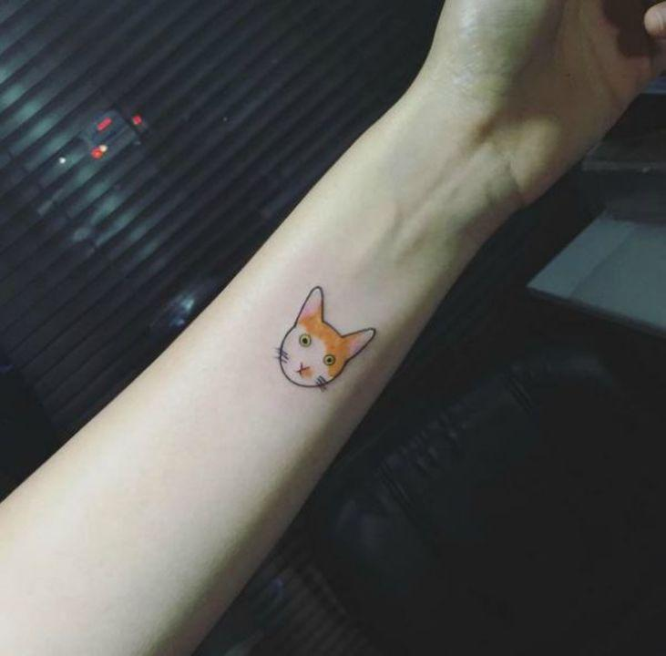 The beauty of this tattoo is in its simplicity. Plus, you can customize the ink to the color of your favorite kitty.