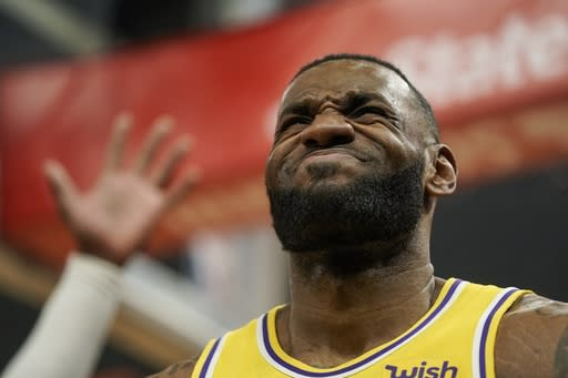 Los Angeles Lakers' LeBron James reacts to a call during the first half of an NBA basketball game against the Milwaukee Bucks Thursday, Dec. 19, 2019, in Milwaukee. (AP Photo/Morry Gash)