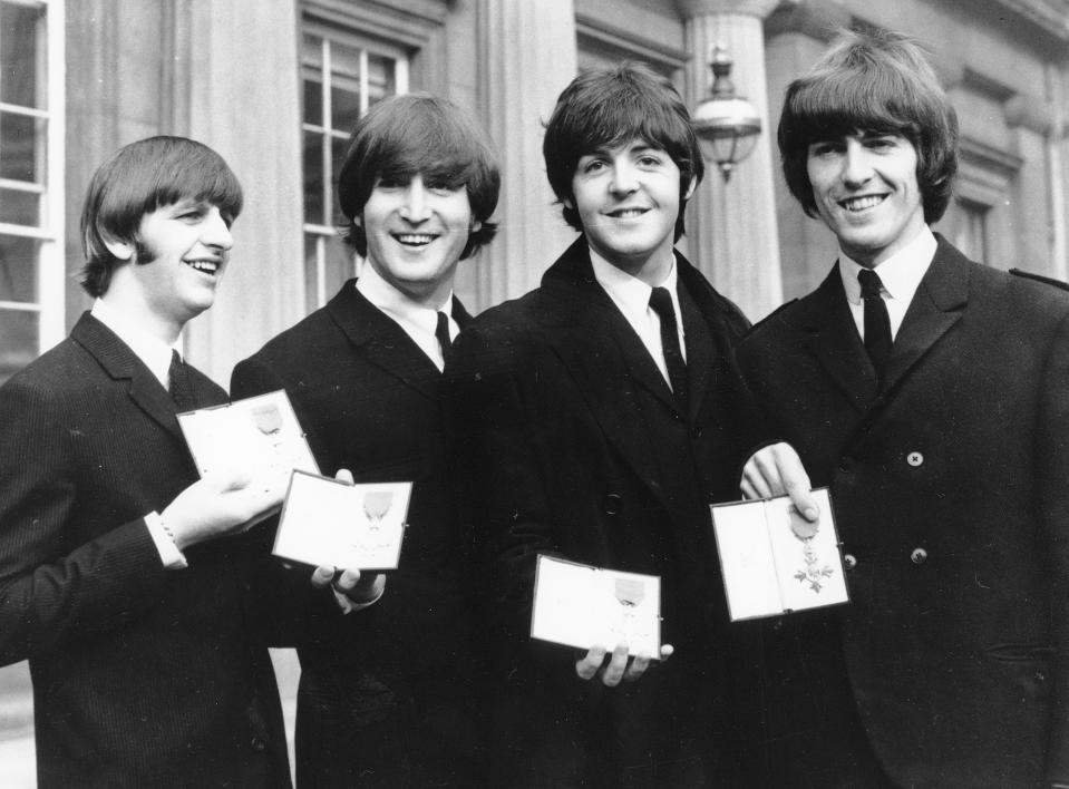 FILE - In this Oct. 26, 1965 file photo The Beatles, from left: Ringo Starr, John Lennon, Paul McCartney and George Harrison smile as they display the Member of The Order of The British Empire medals presented to them by Queen Elizabeth II in a ceremony in Buckingham Palace in London, England. Starr, the 77-year-old, former Beatles drummer received his long-awaited knighthood from Prince William Tuesday March 20, 2018. (AP Photo, File)