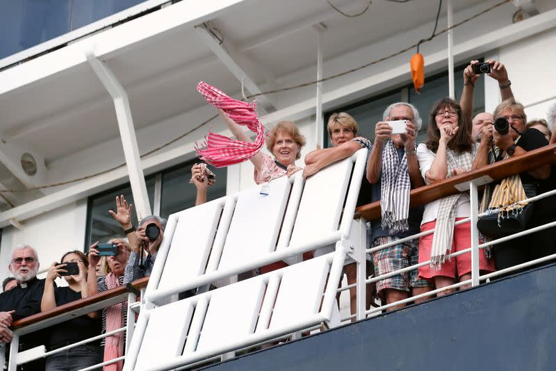 Passengers onboard MS Westerdam, a cruise ship that spent two weeks at sea after being turned away by five countries over fears that someone aboard might have the coronavirus, are seen in Sihanoukville