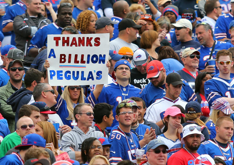 FILE - In this Sept. 14, 2014, file photo, a fan holds a sign thanking prospective Buffalo Bills owners Terry and Kim Pegula during the first half of an NFL football game between the Bills and the Miami Dolphins in Orchard Park, N.Y. The Pegulas took a step closer to buying the Bills after their NFL-record $1.4 billion purchase agreement was unanimously approved by the league's finance committee Wednesday, Sept. 17, 2014. (AP Photo/Bill Wippert, File)