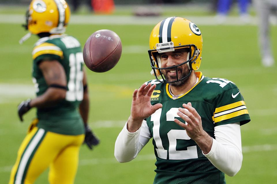 GREEN BAY, WISCONSIN - JANUARY 16: Aaron Rodgers #12 of the Green Bay Packers warms up before the NFC Divisional Playoff game against the Los Angeles Rams at Lambeau Field on January 16, 2021 in Green Bay, Wisconsin. (Photo by Dylan Buell/Getty Images)
