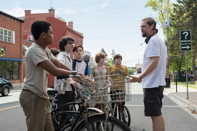 Director Andy Muschietti (right) works with young stars Chosen Jacobs, Finn Wolfhard, Jaeden Martell, Sophia Lillis and Jeremy Ray Taylor on the set of