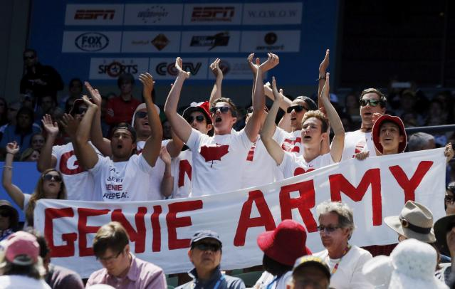 "Supporters of Eugenie Bouchard of Canada, calling themselves the ""Genie Army"", cheer for her during her women's singles quarter-final match against Ana Ivanovic of Serbia at the Australian Open 2014 tennis tournament in Melbourne January 21, 2014. REUTERS/Jason Reed (AUSTRALIA - Tags: SPORT TENNIS)"