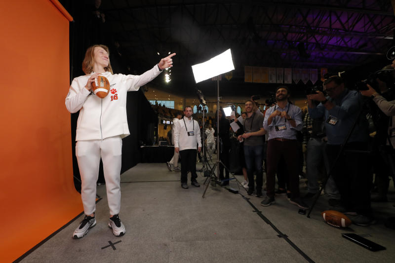 Clemson quarterback Trevor Lawrence poses during media day for NCAA College Football Playoff national championship game Saturday, Jan. 11, 2020, in New Orleans. Clemson is scheduled to play LSU on Monday. (AP Photo/Gerald Herbert).