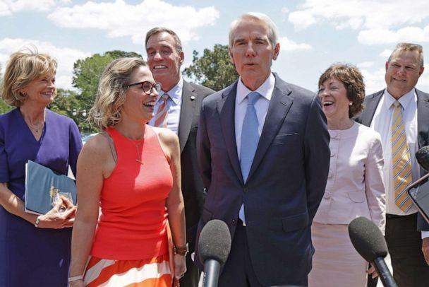 PHOTO: US Senators Lisa Murkowski, Kyrsten Sinema, Mark Warner, Rob Portman, Susan Collins and Jon Tester speak to the press after a meeting with President Joe Biden at the White House on June 24, 2021 in Washington, D.C. to discuss infrastructure plans. (Alex Wong/Getty Images, FILE)