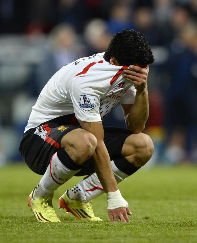"Liverpool's Luis Suarez reacts following their English Premier League soccer match against Crystal Palace at Selhurst Park in London May 5, 2014. REUTERS/Dylan Martinez (BRITAIN - Tags: SPORT SOCCER) FOR EDITORIAL USE ONLY. NOT FOR SALE FOR MARKETING OR ADVERTISING CAMPAIGNS. NO USE WITH UNAUTHORIZED AUDIO, VIDEO, DATA, FIXTURE LISTS, CLUB/LEAGUE LOGOS OR ""LIVE"" SERVICES. ONLINE IN-MATCH USE LIMITED TO 45 IMAGES, NO VIDEO EMULATION. NO USE IN BETTING, GAMES OR SINGLE CLUB/LEAGUE/PLAYER PUBLICATIONS"