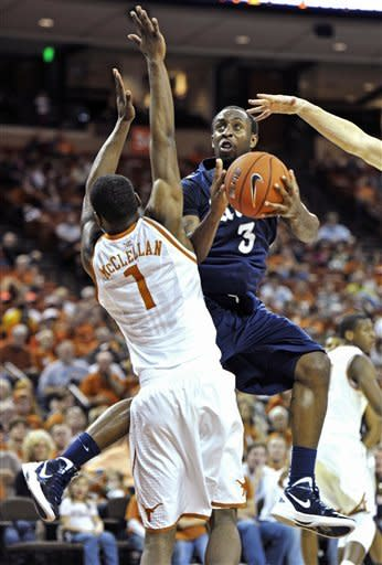 Rice guard Tamir Jackson (3) looks to shoot against Texas guard Sheldon McClellan (1) during the second half of an NCAA college basketball game, Saturday, Dec. 31, 2011, in Austin, Texas. Texas won 73-59. (AP Photo/Michael Thomas)