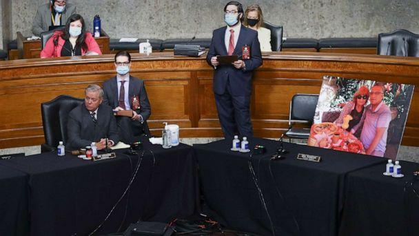 PHOTO: Senate Judiciary Committee Chairman Sen. Lindsey Graham, presides next to an image of people who've been helped by the Affordable Care Act, occupying the seat of Sen. Dianne Feinstein, during the Senate Judiciary Committee meeting, Oct. 22, 2020. (Hannah Mckay/Pool via AP)