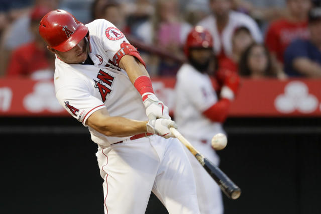 Los Angeles Angels' Mike Trout hits a RBI-single against the Boston Red Sox during the second inning of a baseball game in Anaheim, Calif., Saturday, Aug. 31, 2019. (AP Photo/Chris Carlson)