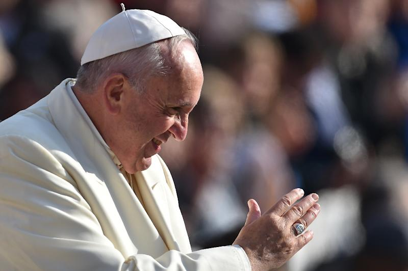 Pope Francis greets the crowd during his weekly general audience at St Peter's square on November 11, 2015 at the Vatican