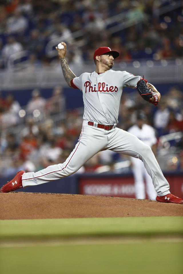 Philadelphia Phillies starting pitcher Vince Velasquez (21) delivers during the first inning of a baseball game against the Miami Marlins on Sunday, April 14, 2019, in Miami. (AP Photo/Brynn Anderson)