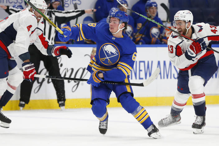 Buffalo Sabres forward Victor Olofsson (68) skates between Washington Capitals' Brenden Dillon (4) and Tom Wilson (43) during the second period of an NHL hockey game Friday, Jan. 15, 2021, in Buffalo, N.Y. (AP Photo/Jeffrey T. Barnes)
