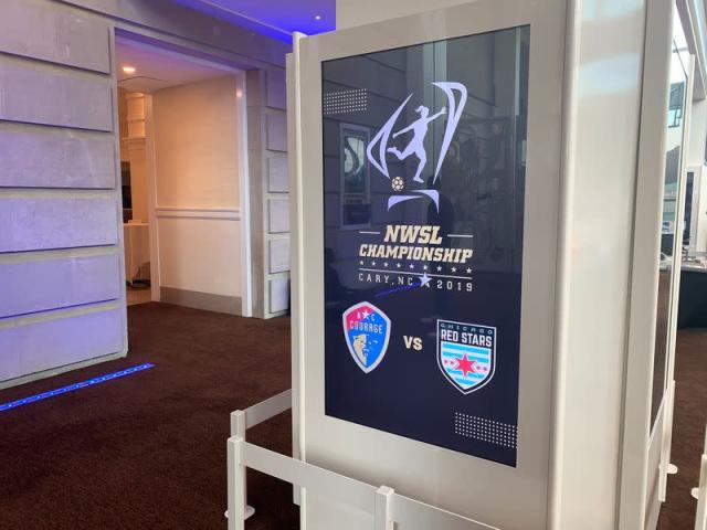A logo for the National Women's Soccer League (NWSL) is seen inside the Duke Energy Center for the Performing Arts ahead of a media event with players from the North Carolina Courage and Chicago Red Stars teams