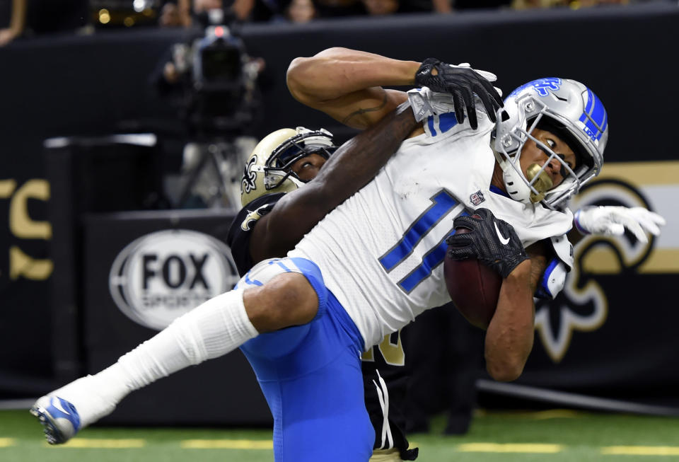 <p>Detroit Lions wide receiver Marvin Jones (11) pulls in a touchdown reception over New Orleans Saints cornerback Ken Crawley in the second half of an NFL football game in New Orleans, Sunday, Oct. 15, 2017. (AP Photo/Bill Feig) </p>