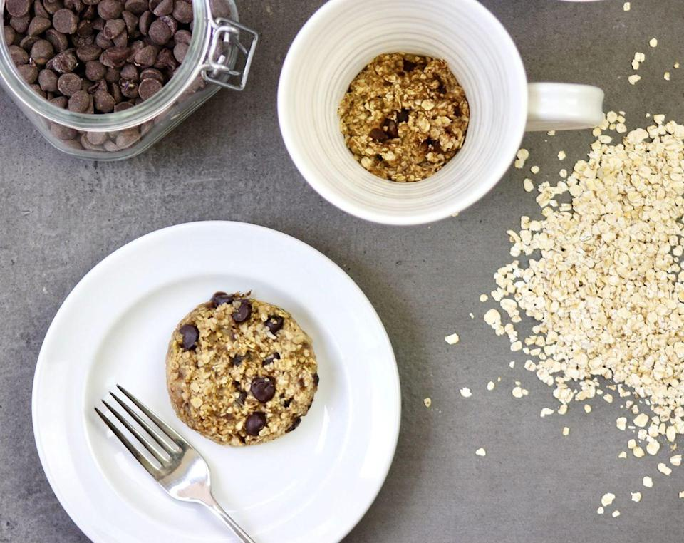 """<p>Mug cookies keep portions in check, and this one has an oh-so satisfying chewy texture.</p><p><a class=""""link rapid-noclick-resp"""" href=""""https://kellyjonesnutrition.com/4-ingredient-chocolate-chip-mug-cookie/"""" rel=""""nofollow noopener"""" target=""""_blank"""" data-ylk=""""slk:GET THE RECIPE"""">GET THE RECIPE</a></p><p><em>Per serving: 120 calories, 3.5 g fat (2 g saturated), 21 g carbs, 40 mg sodium, 6 g sugar, 3 g fiber, 3 g protein</em></p>"""