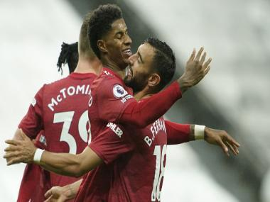 Premier League: Manchester United score late goals to beat Newcastle; Man City overcome Arsenal