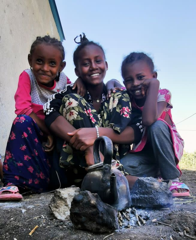 Ethiopian children, who fled the ongoing fighting in Tigray region, are seen at the al-Fashqa refugee camp in the Sudan-Ethiopia border town of al-Fashqa, in eastern Kassala state
