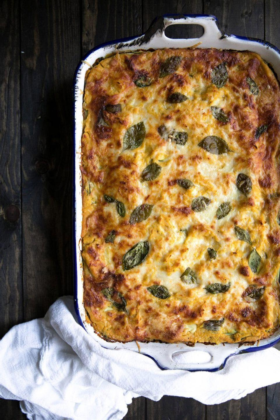 """<p>Filled with ricotta, mozzarella, <em>and </em>Parmesan cheese, your guests will be begging for seconds of this vegetarian dish.</p><p><strong>Get the recipe at <a href=""""https://theforkedspoon.com/butternut-squash-zucchini-spinach-lasagna/"""" rel=""""nofollow noopener"""" target=""""_blank"""" data-ylk=""""slk:The Forked Spoon"""" class=""""link rapid-noclick-resp"""">The Forked Spoon</a>.</strong></p>"""